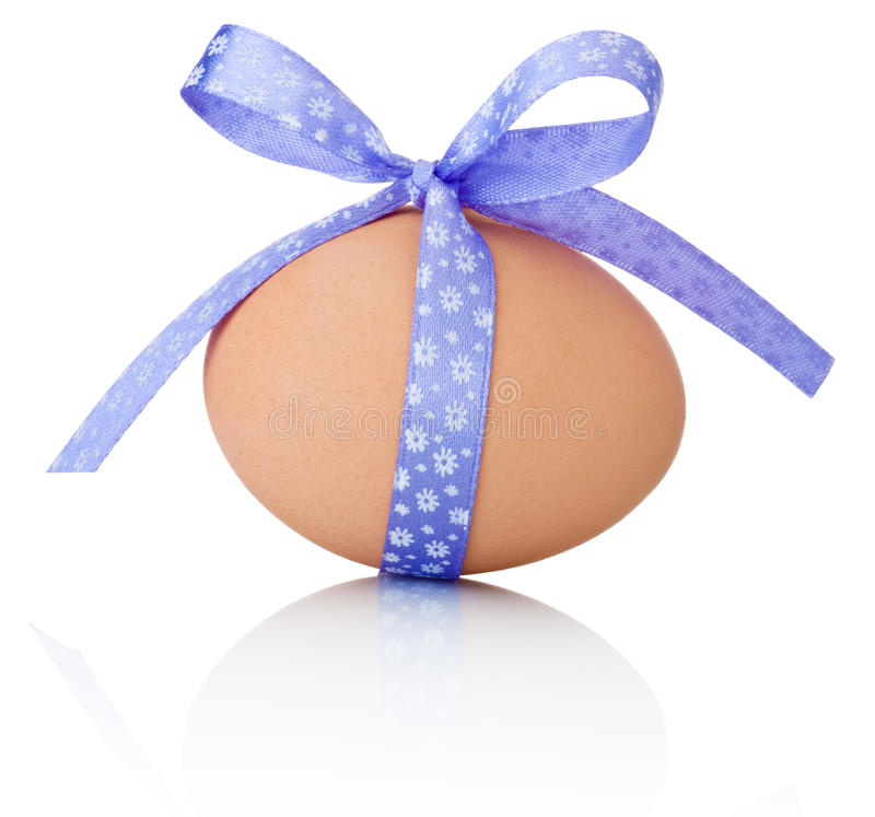 Easter egg with festive purple bow on white background stock images