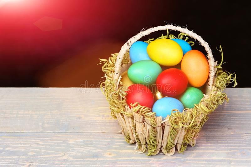 Spring easter holiday celebration with colorful eggs in basket stock photography