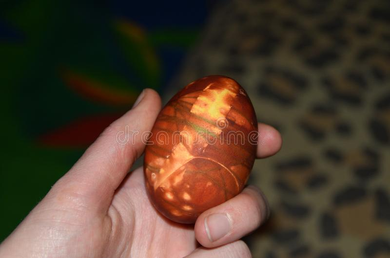 Easter egg in hand. stock photography