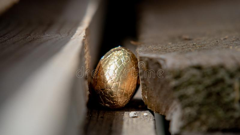 Easter egg hidden on the boards royalty free stock photos
