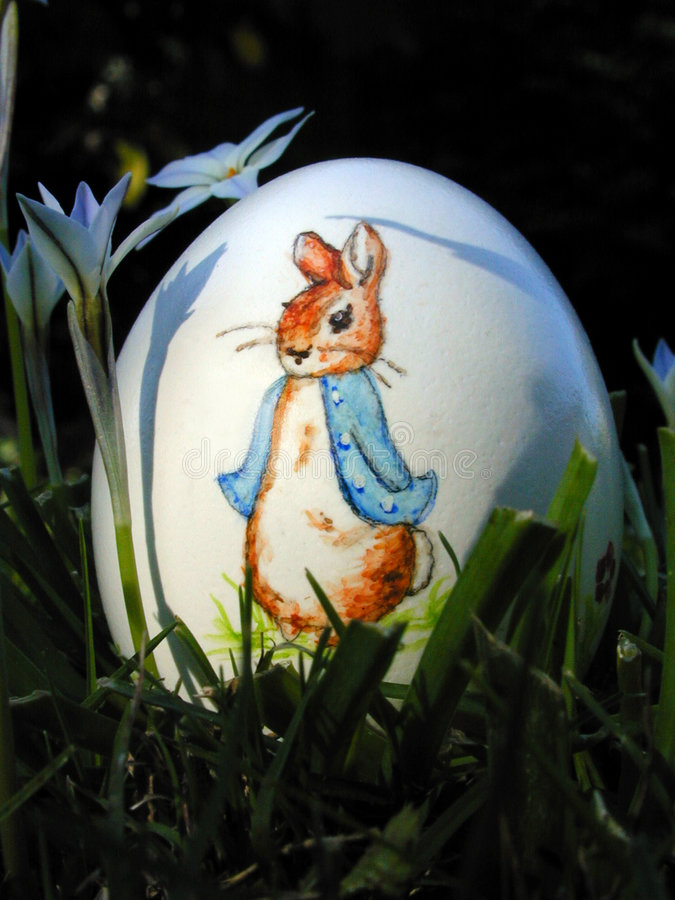 Easter egg hidden in the grass. Is discovered royalty free stock images