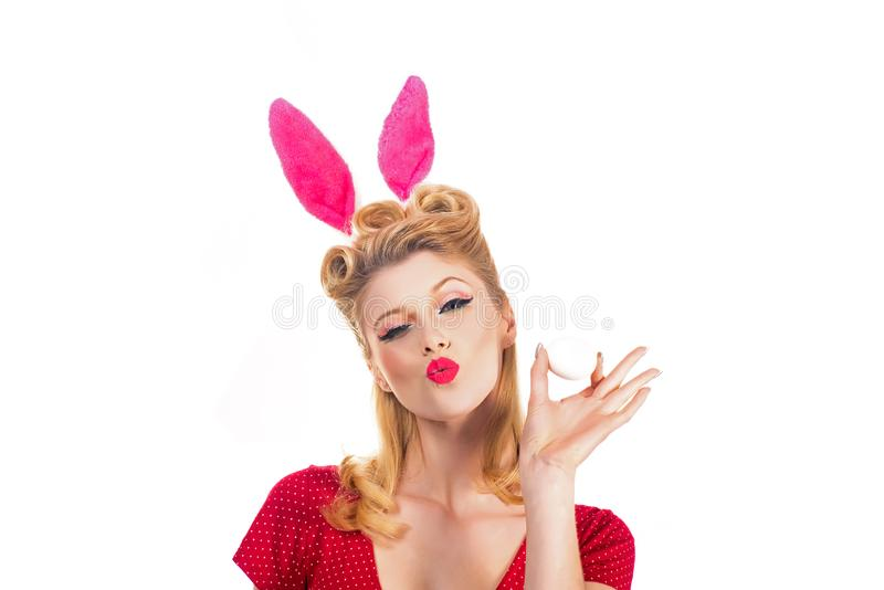 Easter egg hunting - Easter day concept. Isolated white background. Pin up Easter. Bunny ears concept. Woman wearing a. Mask Easter bunny and looks very royalty free stock images