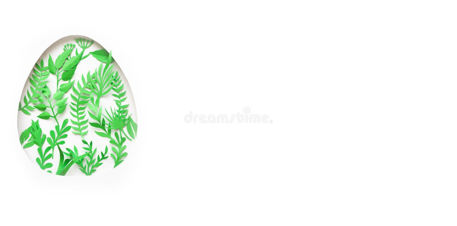 Easter egg made of paper leaves on white background. Cut from paper royalty free stock image