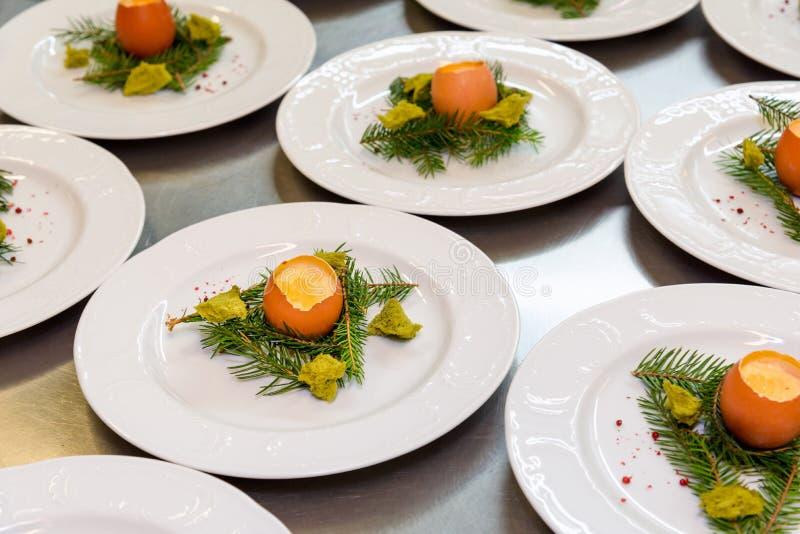 Easter egg meal restaurant kitchen. Easter meal at a restaurant kitchen, gourmet egg dish cooking stock images