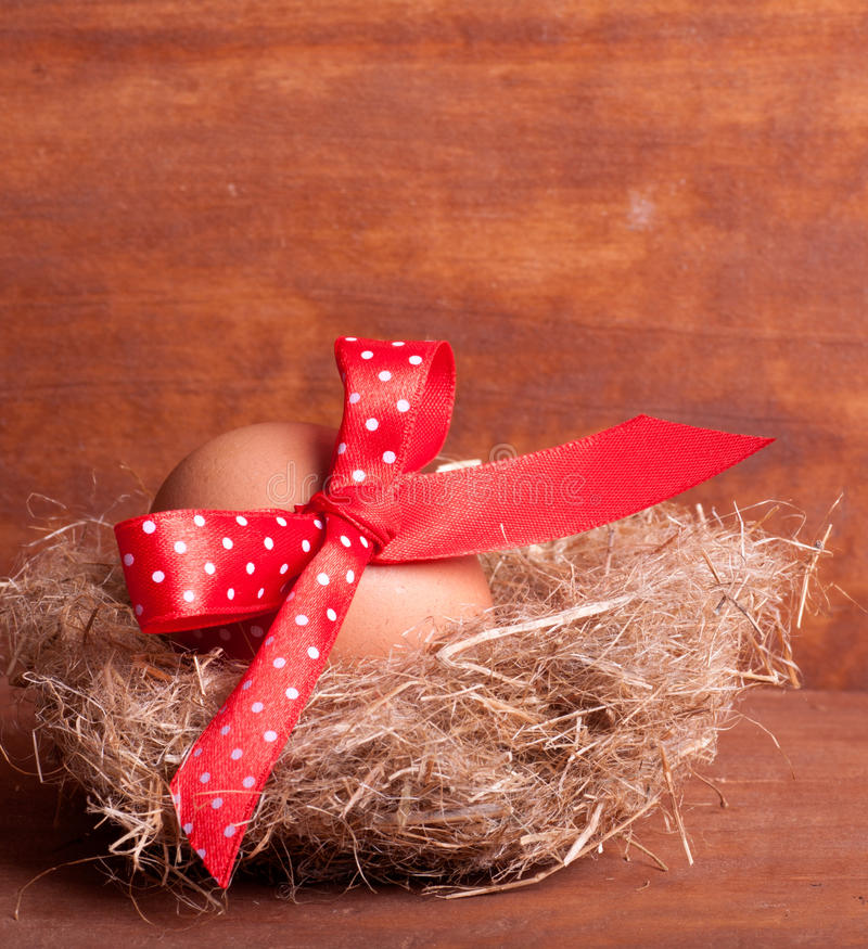 Download Easter Egg In The Nest With A Red Ribbon Stock Image - Image: 29008451