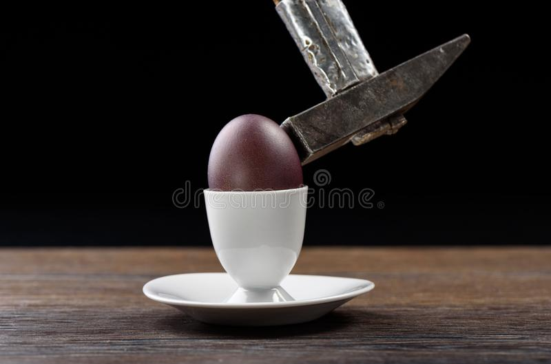 Easter egg open with a hammer stock images