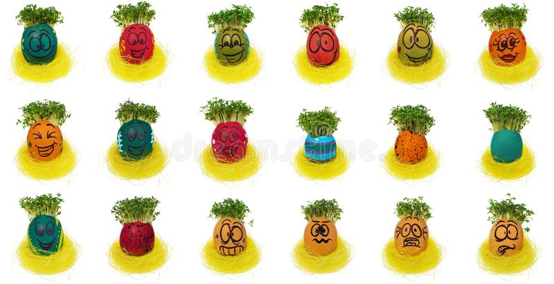 Easter egg painted in a funny smiley face and colorful patterns royalty free stock image