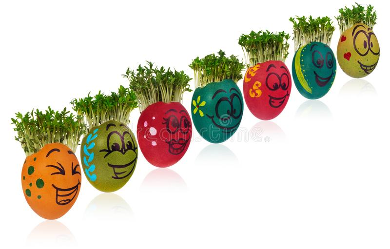 Easter egg painted in a funny smiley girl face and colorful patterns with cress like hair. royalty free stock photo