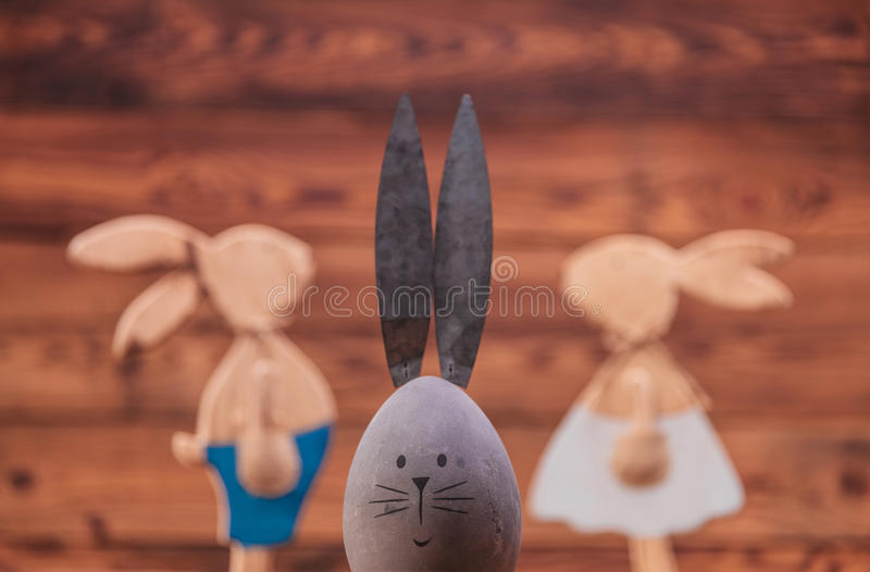 Easter egg with rabbit ears in front of bunnies couple stock photography