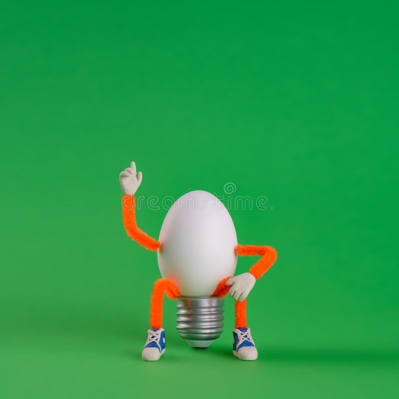 Easter egg toy in the shape of a light bulb on a gree royalty free stock image