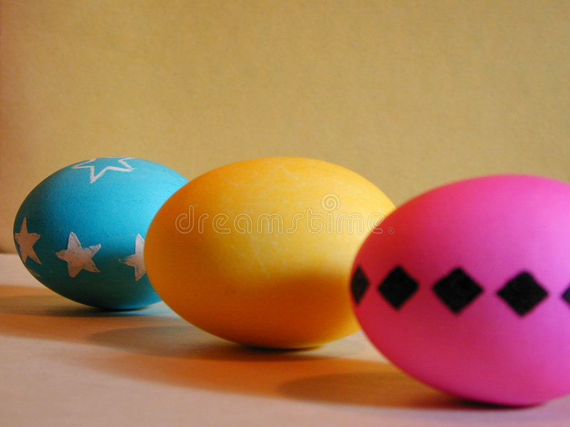 Easter Egg Trio. A trio of Easter Eggs - Pink, Yellow, and Aqua stock photo