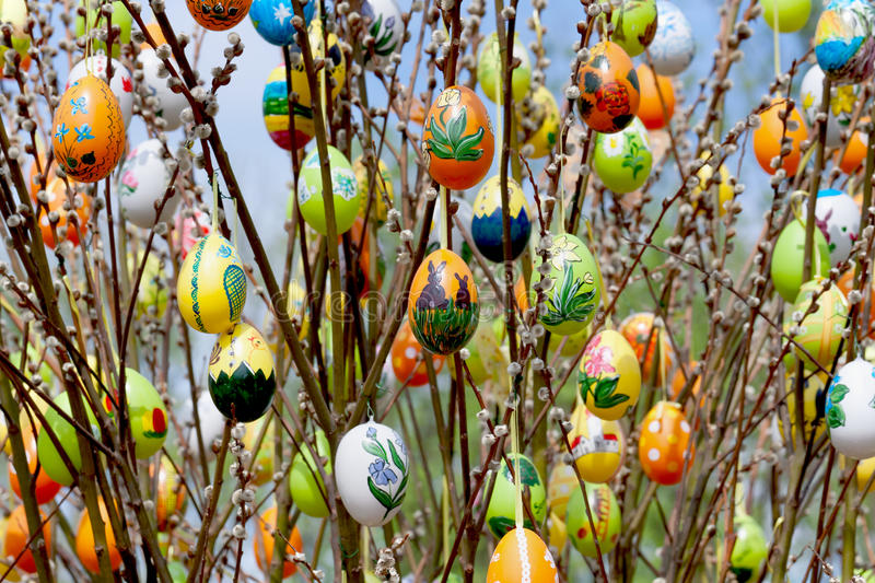Easter egg with willow catkins. Colorfully painted Easter egg with willow catkins stock photography