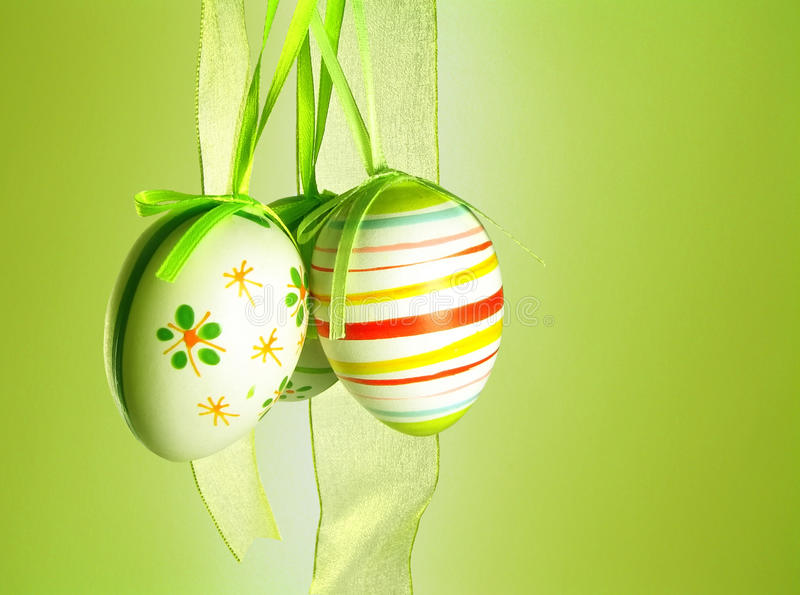 Easter eggs. With a ribbon on a green background stock photos