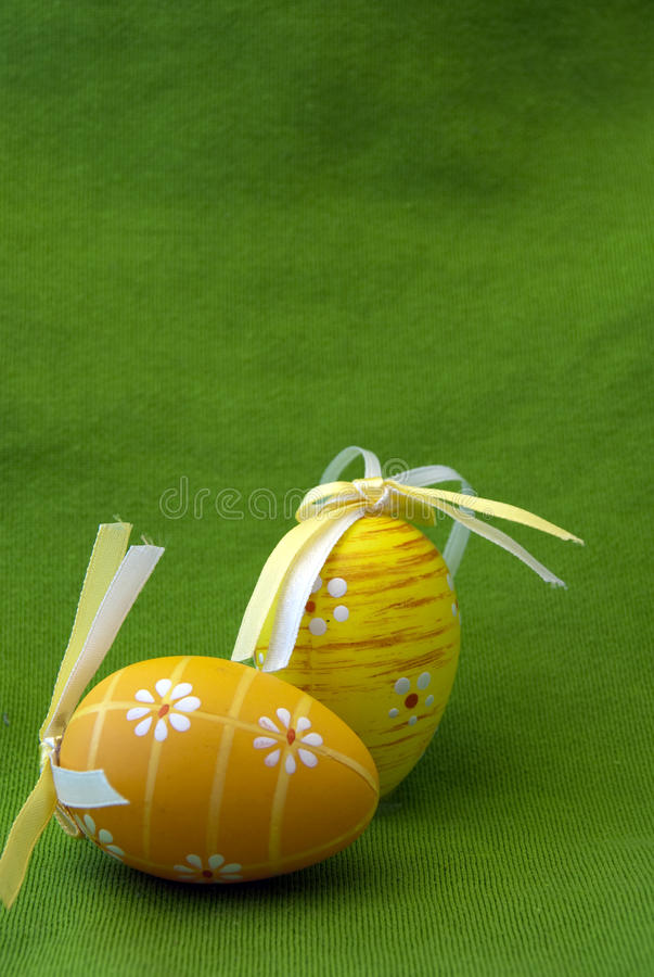 Easter eggs. Painted Easter eggs in green background stock image