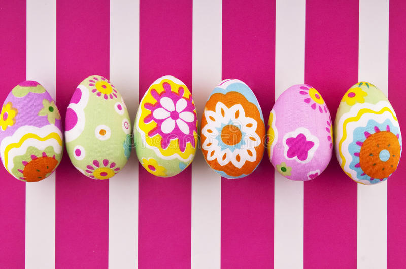 Easter eggs. On a striped background royalty free stock photography