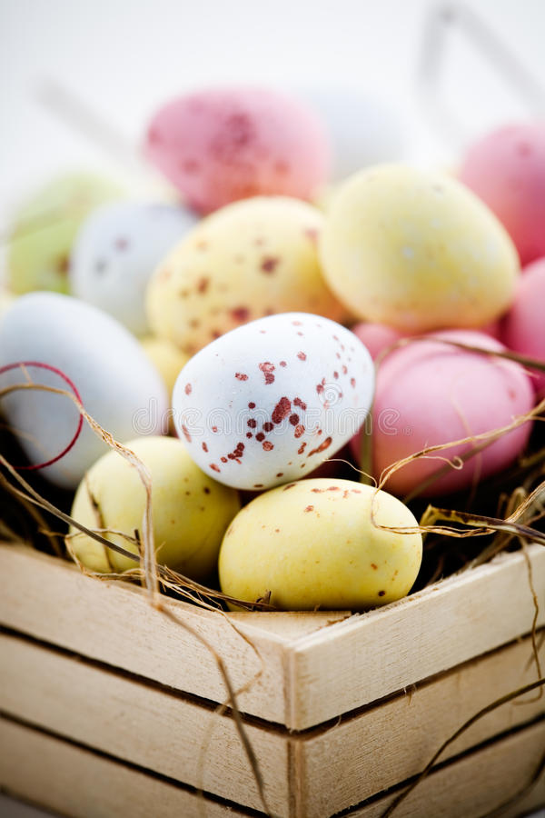 Easter eggs. Chocolate easter eggs in little wooden box stock photo