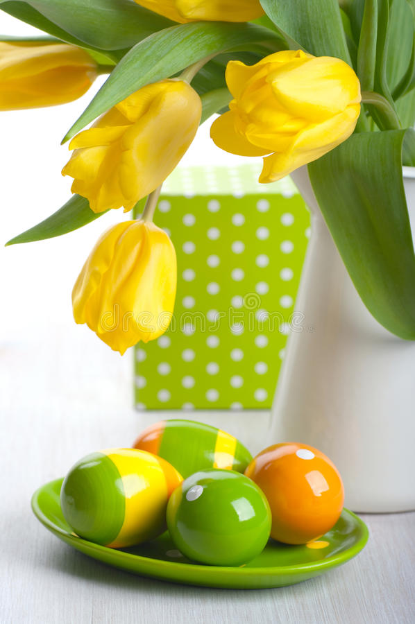 Easter eggs. Colorful Easter eggs on a plate stock photos