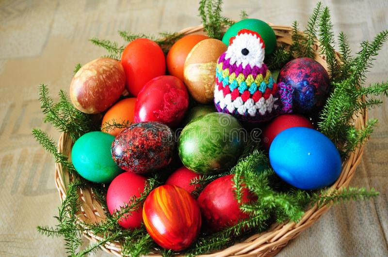 Easter eggs. Colorful easter eggs composition in a wicker basket stock images