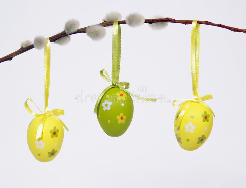 The Easter Eggs. Three Easter Eggs hanging from willow twig royalty free stock photos