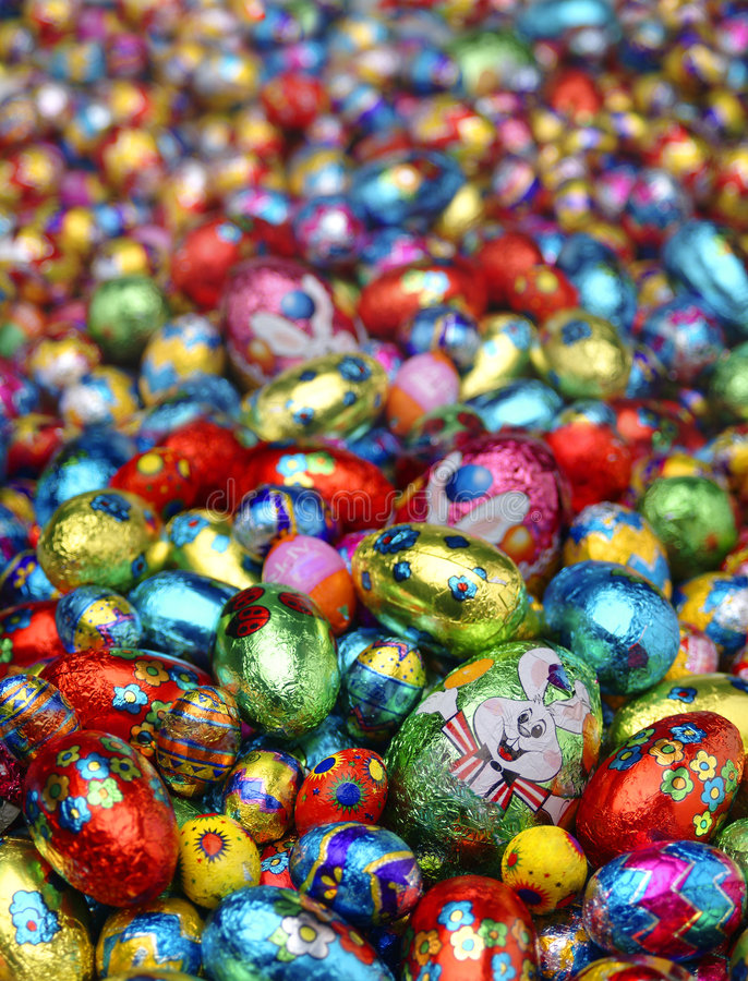 Easter eggs. A big bed of colorful aluminium wraped chocolate egg whith focus in the front