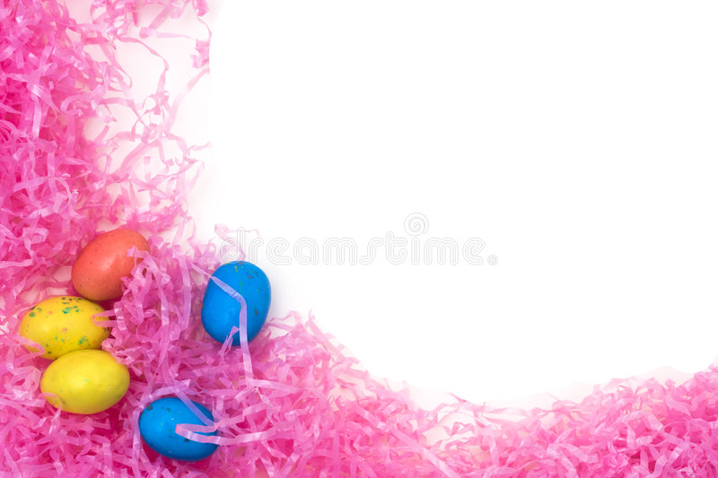 Easter Eggs. On pink plastic grass with white copy space royalty free stock image