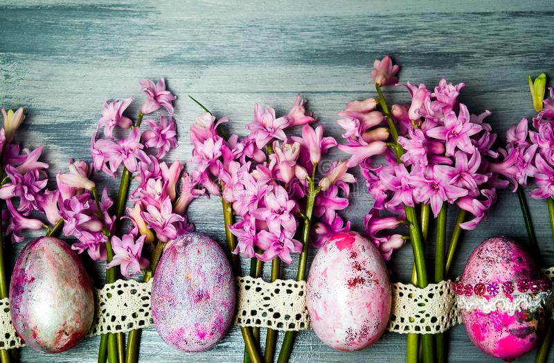 Easter eggs arranged with fresh hyacinth flowers royalty free stock image