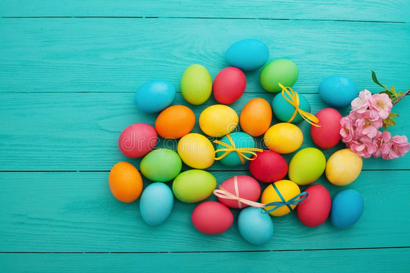 Easter Eggs background. Colorful egg. Top view and mock up. Holiday fun. Food design. Spring Flowers. Easter Eggs background. Colorful egg. Top view and mock up stock photography