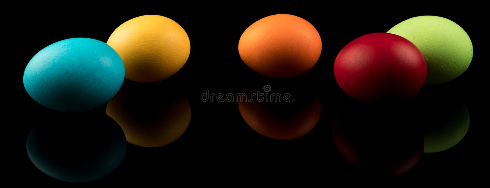 Easter Eggs Banner. Colorful Easter Eggs on black background with reflection. Modern Design royalty free illustration