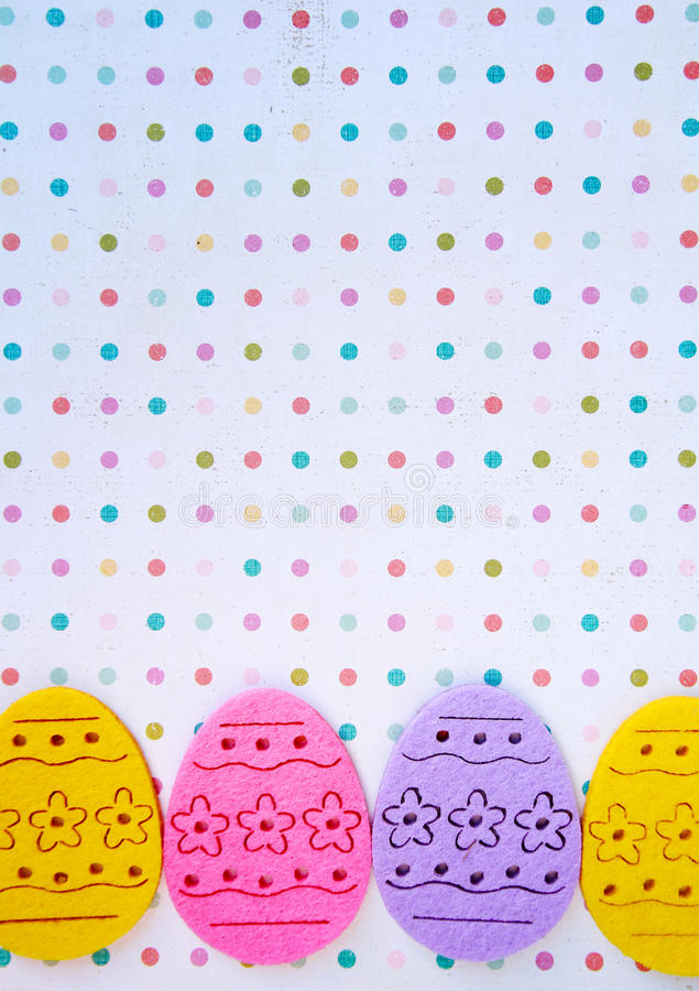 Easter eggs banner. Decorated felt easter eggs yellow, pink, and lilac on a polka dots background stock photography