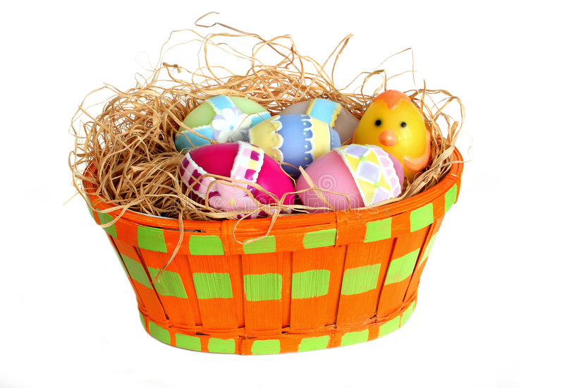 Easter eggs in a basket. Colorful wax Easter eggs in a basket on white background royalty free stock image