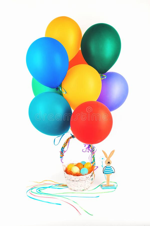 Easter eggs basket with balloons and bunny isolated royalty free stock images