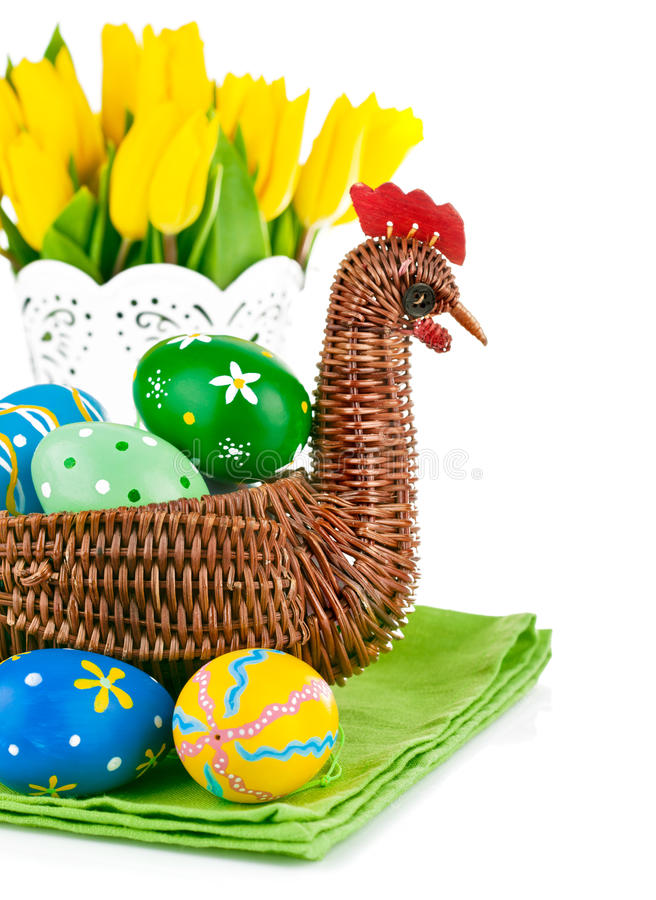 Easter eggs in basket with flowers royalty free stock photo