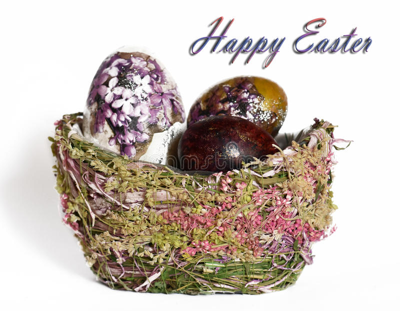 Easter eggs in a basket made of natural materials royalty free stock images