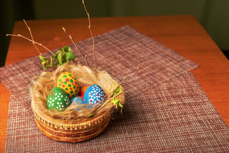 Easter eggs are in the basket. Painted in the colors of the rainbow. Nest of straw. stock photo