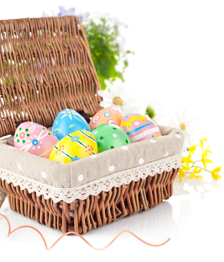 Easter Eggs In Basket With Spring Flowers Stock Photography