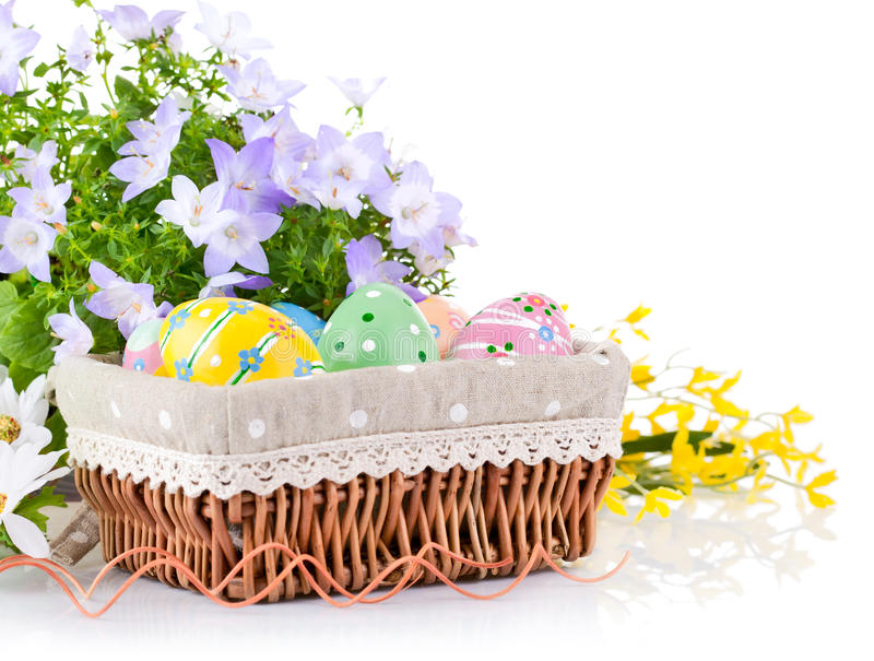 Easter Eggs In Basket With Spring Flowers Stock Images
