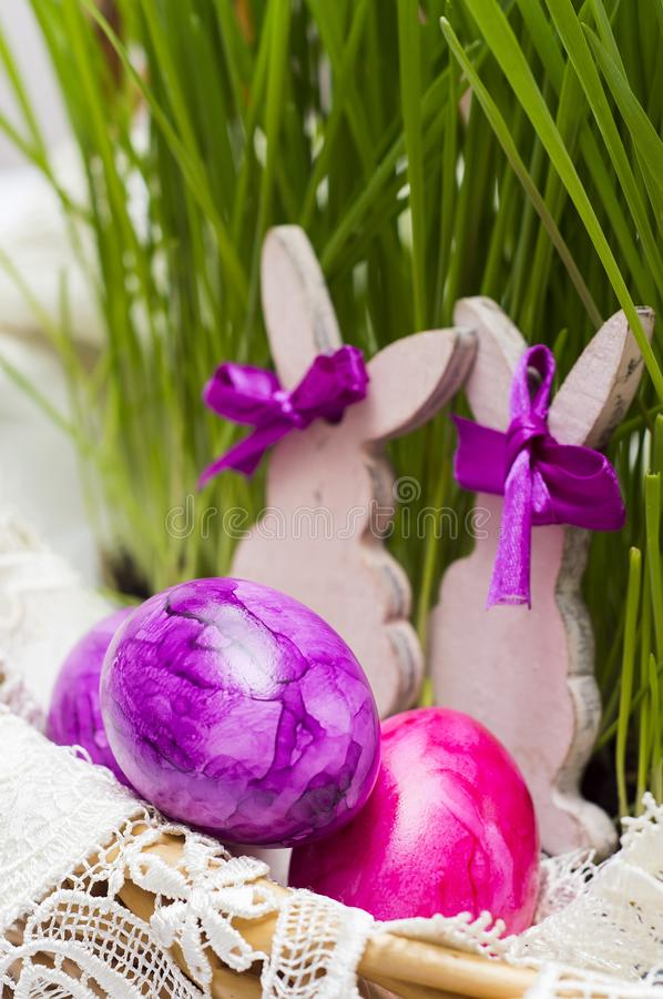 Easter eggs in basket with sprouted wheat. Easter eggs in a basket with sprouted wheat,on table royalty free stock photography