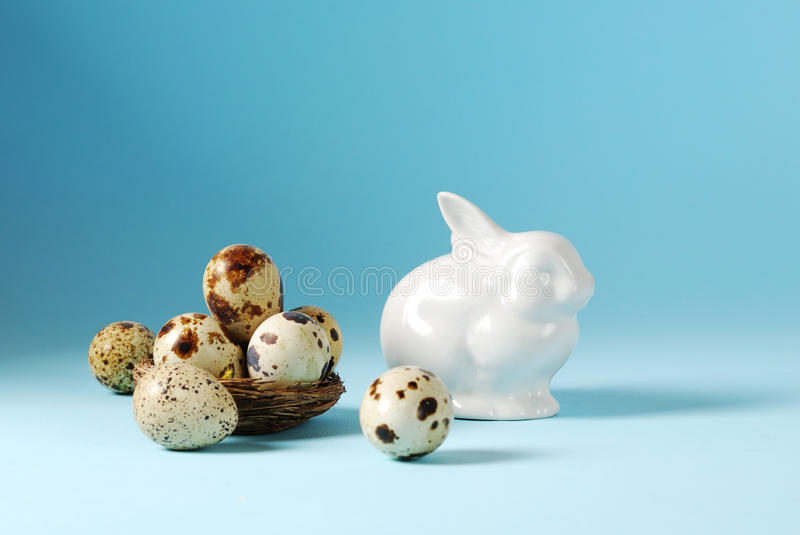 Easter eggs in basket and white porcelain Bunny royalty free stock photos