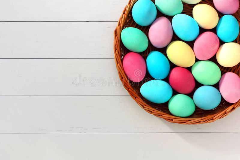 Easter Eggs in Basket on a Wood Background stock photo