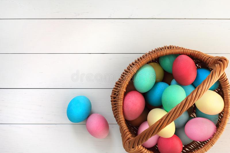 Easter Eggs in Basket on a Wood Background royalty free stock image