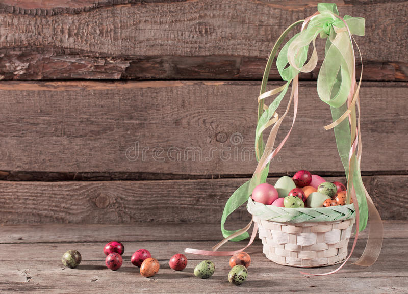 Easter eggs in basket. On wooden background royalty free stock photography