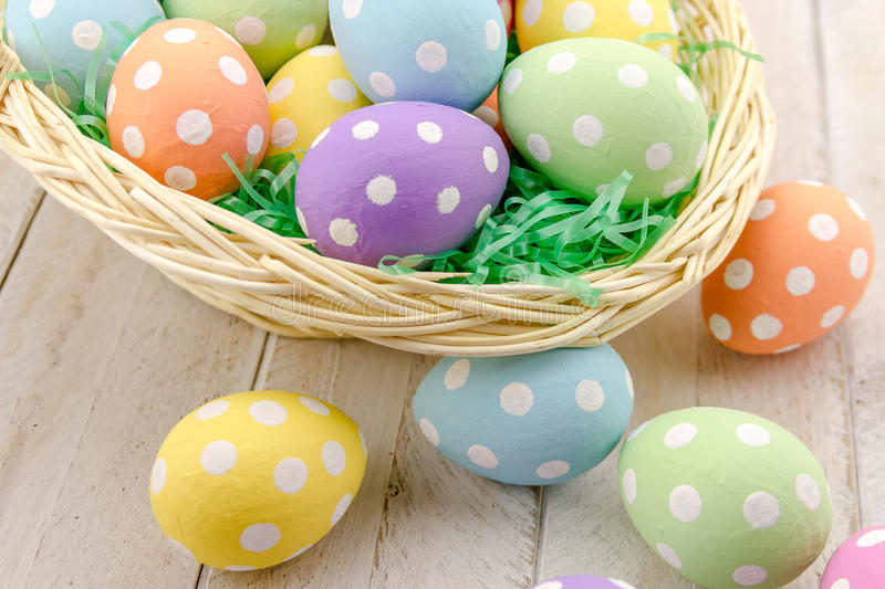 Easter Eggs and Baskets. Close up of Easter basket with green grass filled with brightly colored polka dot Easter eggs stock images