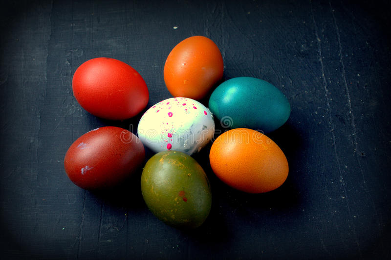 Easter eggs. On black wooden background royalty free stock photos