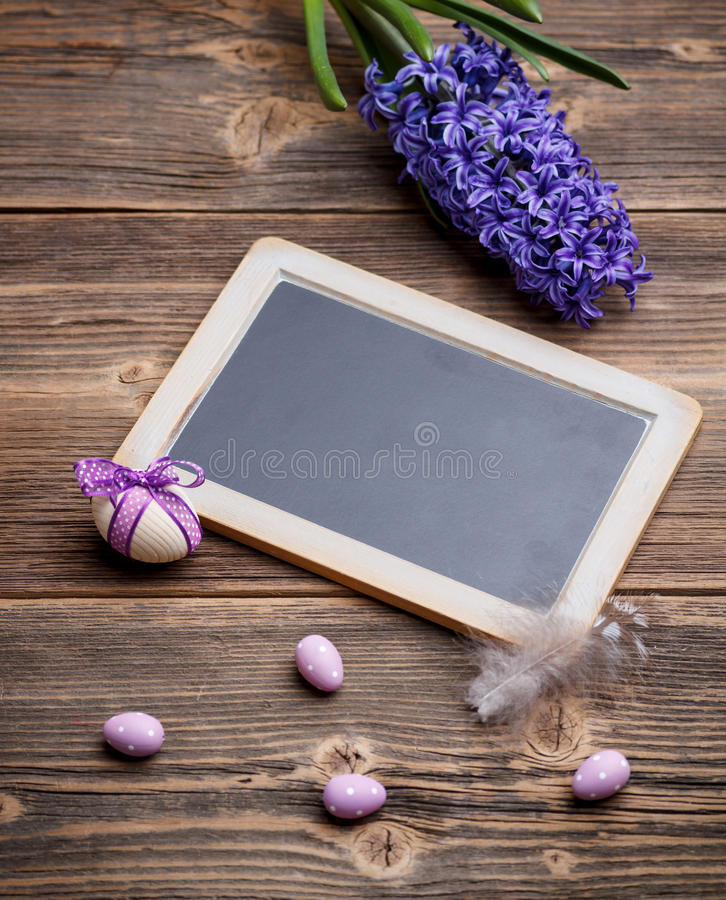 Easter eggs and blackboard stock images