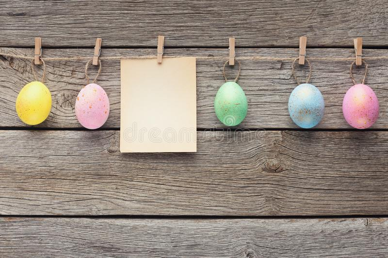 Easter eggs and blank paper with copy space royalty free stock image
