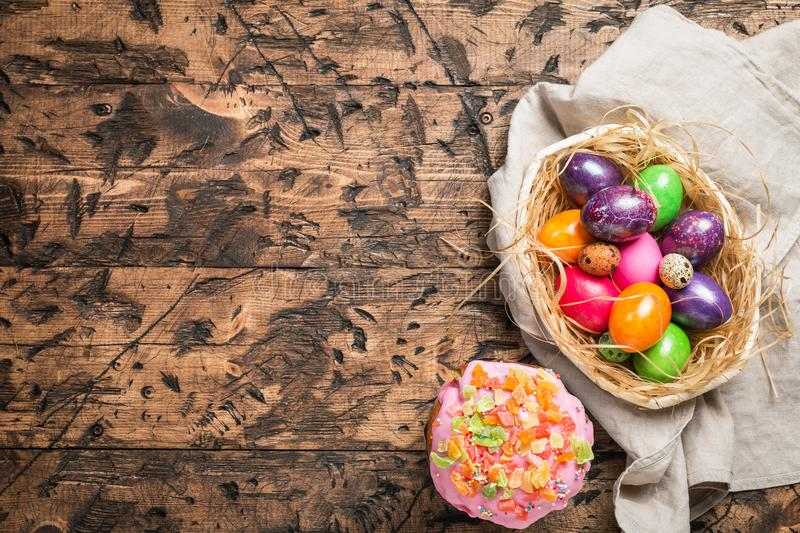 Easter eggs in a bowl. On rustic wooden background, top view royalty free stock photos