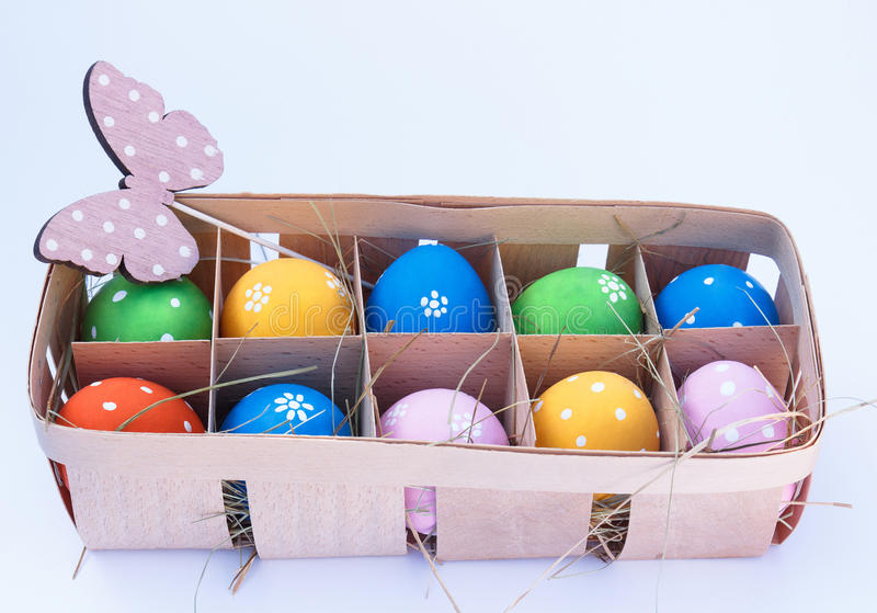 Easter eggs in a box and butterfly royalty free stock images