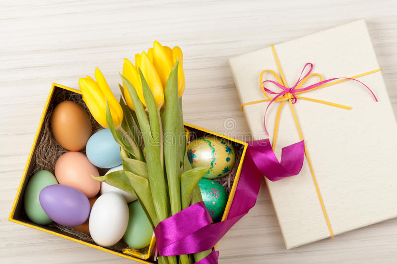 Easter Eggs in a box with colorful tulips stock image