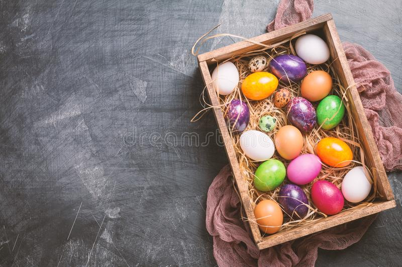 Easter eggs in a box. On black background, top view stock images