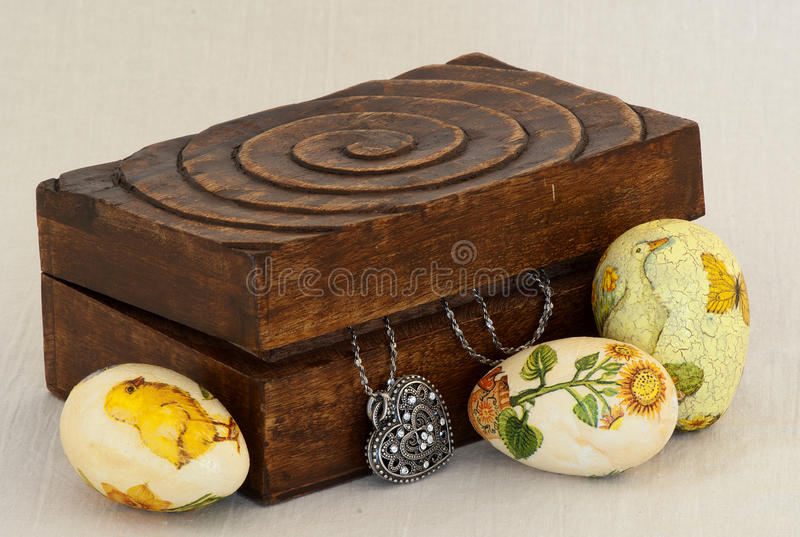 Easter eggs and box with a silver heart